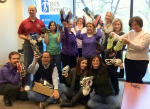 Our BIS team celebrating a wellness initiative with new athletic shoes
